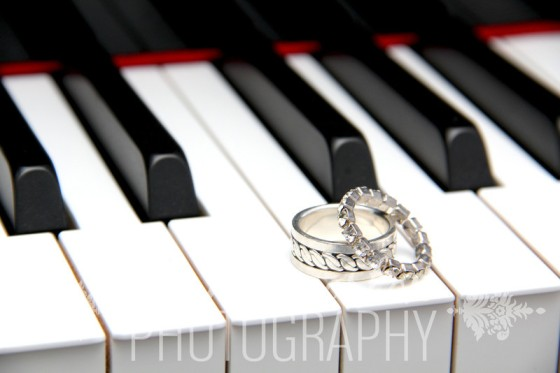 I love this shot; rings on a piano!